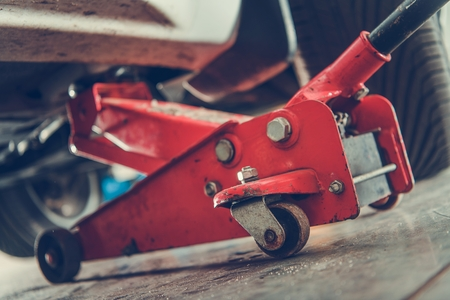 Mechanics Professional Vehicle Lifting Equipment. Floor Jack Car Lift Automotive Service.