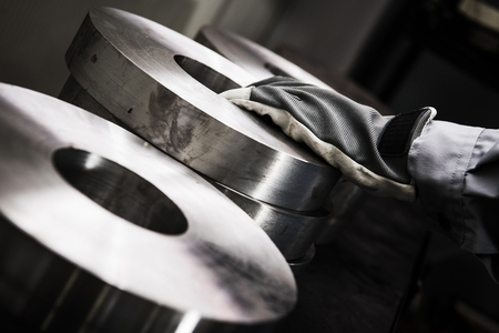 Metalworking Industry Material Closeup Photo. Rings of Metal For Lathe CNC Processing. Reklamní fotografie