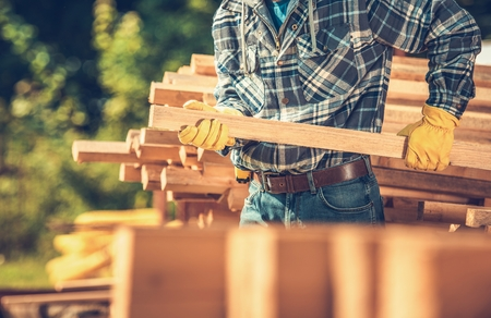 Choosing Wood Building Material. Construction Worker Looking For Some Wood Beams. Reklamní fotografie