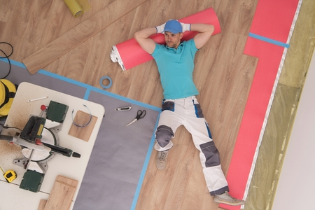Successful Flooring Specialist Taking Short Break to Enjoy Newly Placed Wood Panels. Construction Theme. Reklamní fotografie