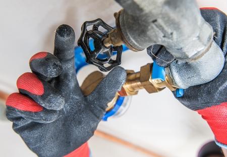 Closing Water Supply Valve Closeup Photo. Plumbing Industry.
