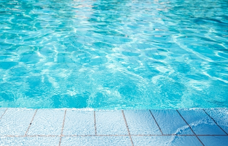 Swimming Pool Edge. Blue Ceramic Tiles. Sport and Recreation Theme.