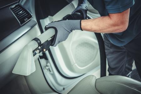 Wet Dry Car Interior Fabrics Vacuuming. Professional Vehicle Cleaning Service. Foto de archivo - 120793270