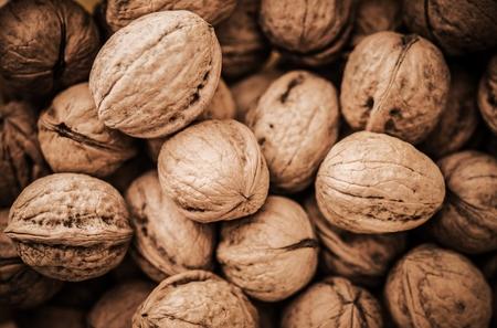 Pile of Organic Walnuts Closeup Photo. Dietary and Food Theme.