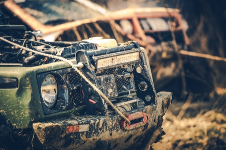 Off Road Expedition. Two Dirty Sport Utility Vehicles Covered by Mud. Motorsport Theme. Reklamní fotografie