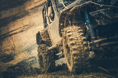 Dirty Off Road Trail Drive. Powerful Sport Utility Vehicle in the Mud. Motorsport Theme.
