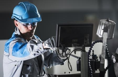 Lathe Metalworking Worker. Caucasian Machine Operator. Industrial Theme. Stock Photo