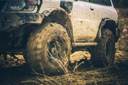 Muddy Trail Off Road Drive. Offroader and the Race. Automotive and Motorsport Theme.