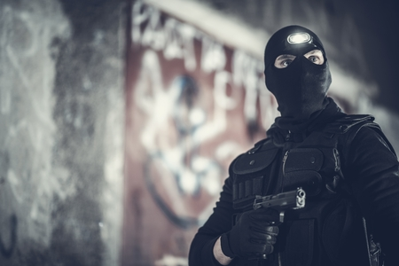 Counter Terrorist Portrait. Men Wearing Mask and Tactical West. Special Forces Soldier. Imagens - 124765133