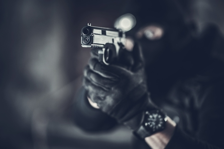 Counter Terrorist with Gun. Shallow Depth of Field Firearm Closeup Photo. Special Forces Theme. Imagens - 124765144