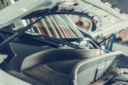 Repairing Modern Car in Auto Service Center. Open Vehicle Hood Closeup.