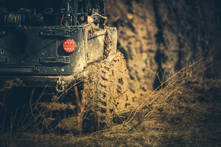 Extreme Off Road Car Trip. Vehicle on a Muddy Trail. Automotive and Motorsport Industry.