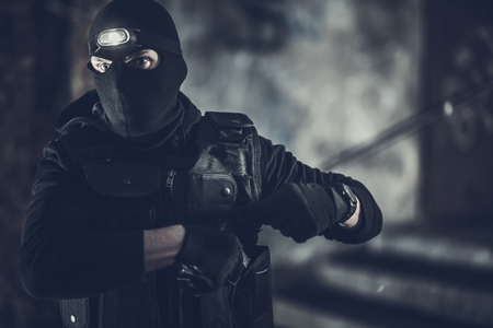 Special Forces Operation. Caucasian Policeman Wearing Black Mask and Uniform. Imagens