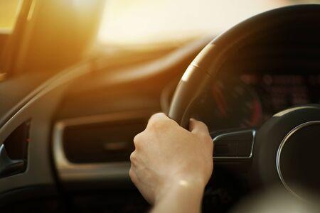 Modern Sporty Car Handling Concept Photo. Caucasian Men Driving His Car. Hand on Steering Wheel Closeup. 写真素材