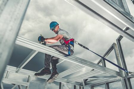 Construction Steel Skeleton Frame Worker Safety Harness Theme. Residential and Commercial Building.