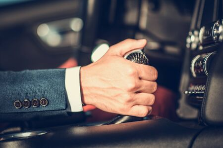 Driving with Automatic Transmission. Caucasian Driver Hand on a Shifter. Car Interior.