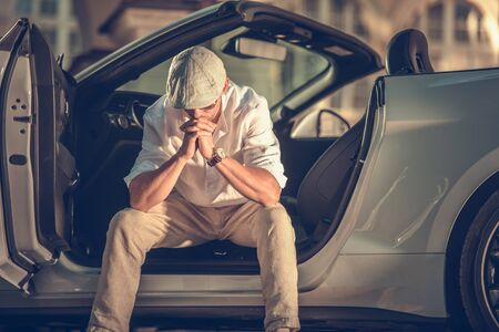 Rich and Successful Problem. Caucasian Men Mentally Devastated Seating Inside His Modern Luxury Convertible Car and Thinking About the Problem.