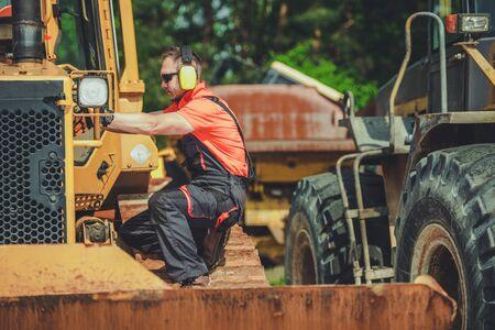 Broken Bulldozer Issue. Professional Heavy Duty Machinery Repair Technician on a Duty.