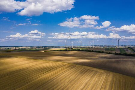 Austrian Farmlands and Countryside Summer Scenery. Wind Turbines and Agriculture. Northern Austria.