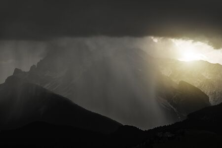 Stormy Mountains Weather. Heavy Rain and Thunderstorm Covering Mountain Landscape. Dangerous Summer Alpine Storm.
