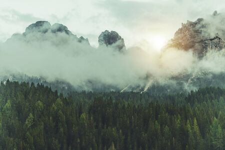 Dolomites Mountain Landscape. Scenic Foggy Peaks with Some Sun Light Coming. Misurina, Italy.