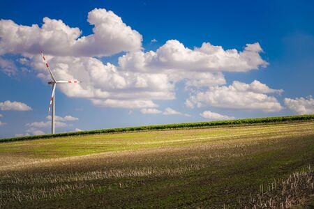 Scenic Farmlands and Renewable Energy Wind Turbine Summer Time Landscape. Northern Austria, Europe.