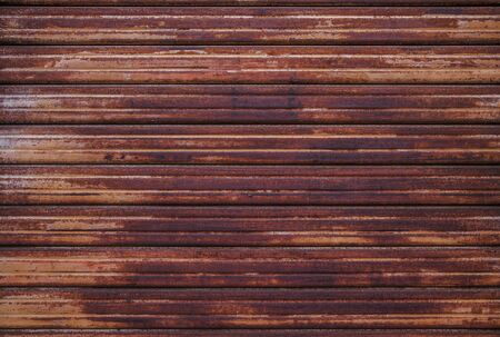 Rusty Sheet of Metal with Horizontal Pattern. Aged Piece of Material Photo Background.
