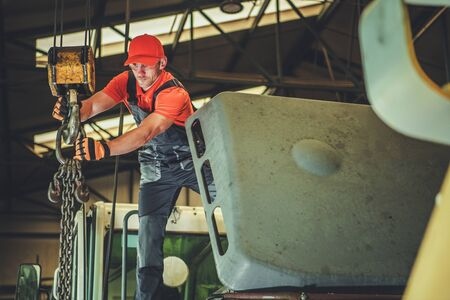 Caucasian Men in His 30s Operating Warehouse Lift. Industrial Theme. Imagens