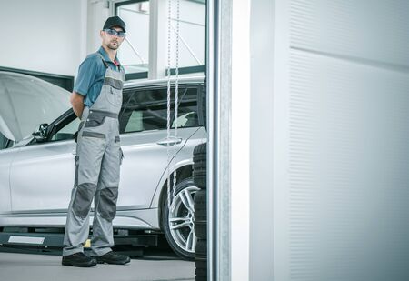 Car Service Job. Caucasian Auto Repair Shop Worker in His 30s. Automotive and Transportation Industry.