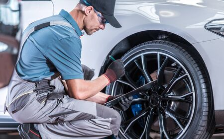 Automotive Industry. Modern Car Servicing in Authorized Dealership Repair Center.