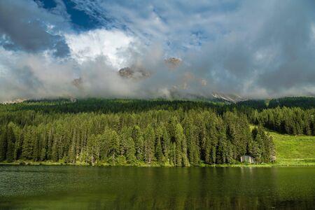 Summer at the Lake Misurina in Italian Dolomites. Scenic Alpine Destination. Фото со стока