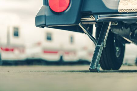 Travel Trailer Leveling and Support Leg Closeup. Caravaning and RVing Concept Photo.