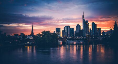 Frankfurt am Main Scenic Summer Sunset. Downtown Financial District Skyline Water illumination. Frankfurt, Hesse State Germany. Stock Photo