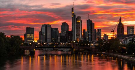 Scenic Burning Sunset Sky Over Frankfurt am Main in Germany. Hesse State Germany. Stock Photo