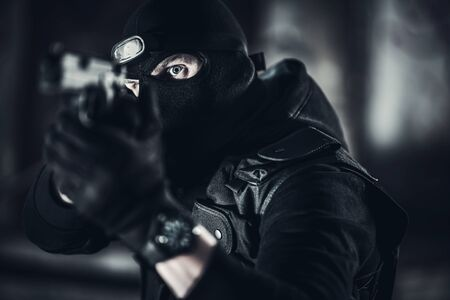 Caucasian Men in His 30s Wearing Balaclava Face Mask with Handgun. Terrorism Concept.