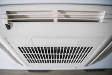 Roof Mount RV Air Condition Unit. Modern Heating and Cooling Device Inside Travel Trailer. Stock Photo - 130052161