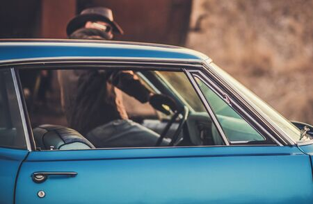 Oldtimer Classic Ride. Caucasian Cowboy Getting Into the Car. Closeup Photo. Transportation and Lifestyle Theme. Stockfoto