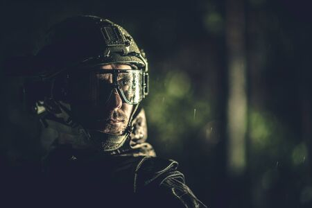Modern Battle Field Soldier Portrait. Dirty and Wet Men Face. Military Theme.