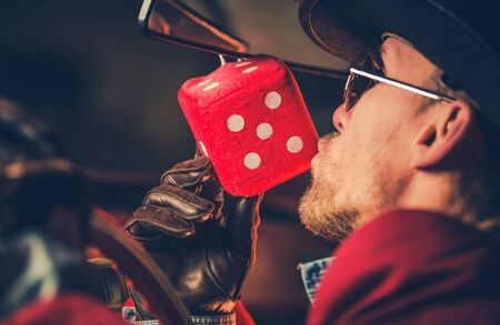 Feeling Lucky Casino Player Kissing Hanged in His Car Red Playing Dice. Gambling Theme. 写真素材 - 130052549