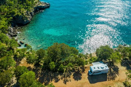 Aerial Photo of Scenic Sea Front RV Campsite. Modern Motorhome Camper Van on the Mediterranean Sea Croatian Coast. Vacation on the Road. Turquoise Bay.