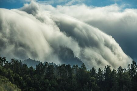 Scenic Waterfall-Like Orographic Clouds in Julian Alps, Slovenia. Meteorological Phenomena.