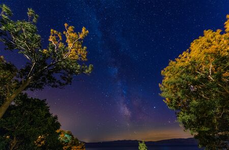 Starry Sky Over Adriatic Sea. Milky Way and the Croatian Landscape. Night Time Photography.
