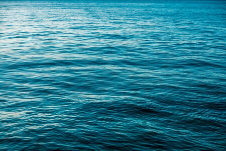 Deep Blue and Calm Sea Surface Nature Background.