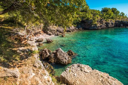 Scenic Adriatic Sea Bay. Rocky Croatian Shoreline Landscape and the Sunshine Weather. Vacation Destination. Turquoise Crystal Clear Water.