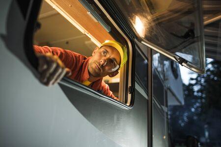 Caucasian Men in His 30s Looking Outside From His RV Camper Van Window. Motorhome Travel Theme.