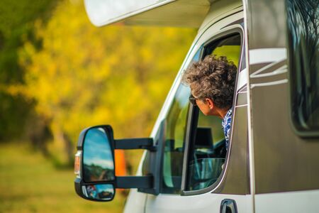 Senior Female Motorhome Driver. Retired Woman and Her Camper Van. Vacation Road Trip. Travel Industry Theme.