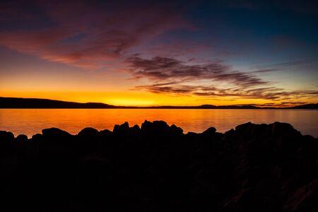 Scenic Rocky Coast Photo Background. Adriatic Sunset Scenery. Stok Fotoğraf