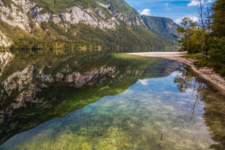 Fall Season at the Lake Bohinj in the Slovenia. Bohinj Valley of the Julian Alps. Triglav National Park.