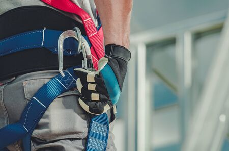 Workers Safety Harness. Caucasian Construction Contractor Safety Equipment Closeup.