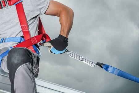 Construction Safety Technologies. Working at Height Contractor Safety Harness Closeup Photo. Steel Building Frame. Stock Photo